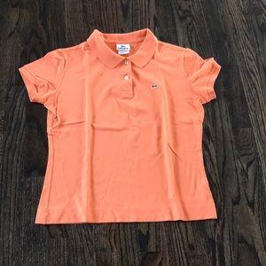 Orange Lacoste shirt